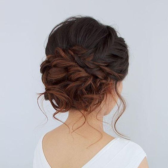 Beautiful romantic messy curled prom or bridal updo