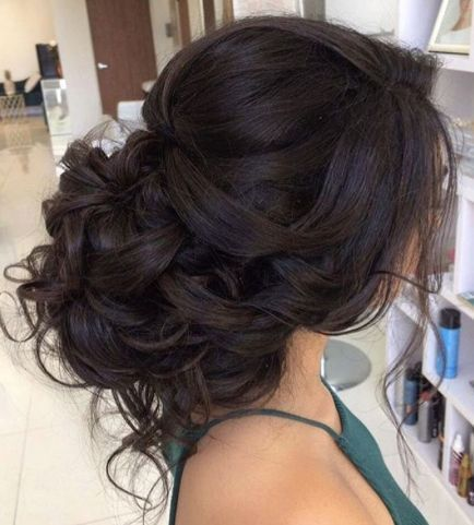 Classic loose curly low updo wedding hairstyle