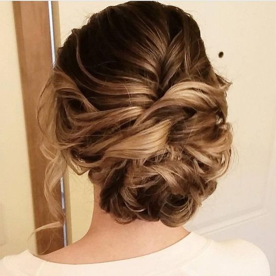 Beautiful messy updo wedding hairstyle